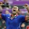 Jo-Wilfried Tsonga celebrates as he leads France to Olympic team gold in London...what?