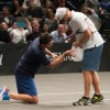 Mark Philippoussis applies ice bag to Andy Roddick's groin