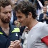 Ernests Gulbis and Roger Federer
