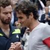 Ernests Gulbis and Roger Federer